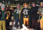 Green Bay Packers fans pose for a photo with FOX 11's Justin Steinbrinck Jan. 13, 2017, during a tailgate party at the FOX 11 Field House.