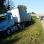 Driver blinded by sun crashes into semi-truck on I-94