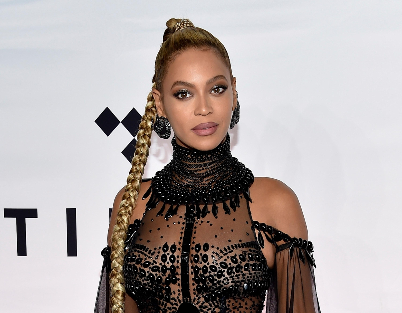 "FILE - In this Oct. 15, 2016, file photo, singer Beyonce Knowles attends the Tidal X: 1015 benefit concert in New York. Beyonce set a record for earning Grammy nominations, announced Tuesday, Dec. 6, in the rock, pop, R&B and rap categories in the same year with her diverse album, ""Lemonade."" Only two other acts have earned nominations in those same four categories, Paul McCartney and Janet Jackson, but never in the same year. (Photo by Evan Agostini/Invision/AP, File)"