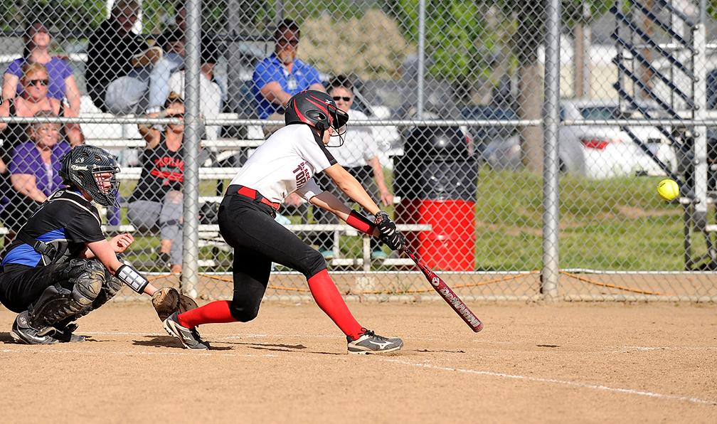 Andy Atkinson / Mail Tribune - North's Lauren Barry gets a hit in the 5th inning.