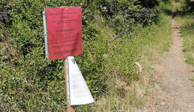 Andy Atkinson / Daily TidingsA level three evacuation notice posted at the PCT trail near the Mount Ashland Aki Road on Monday.
