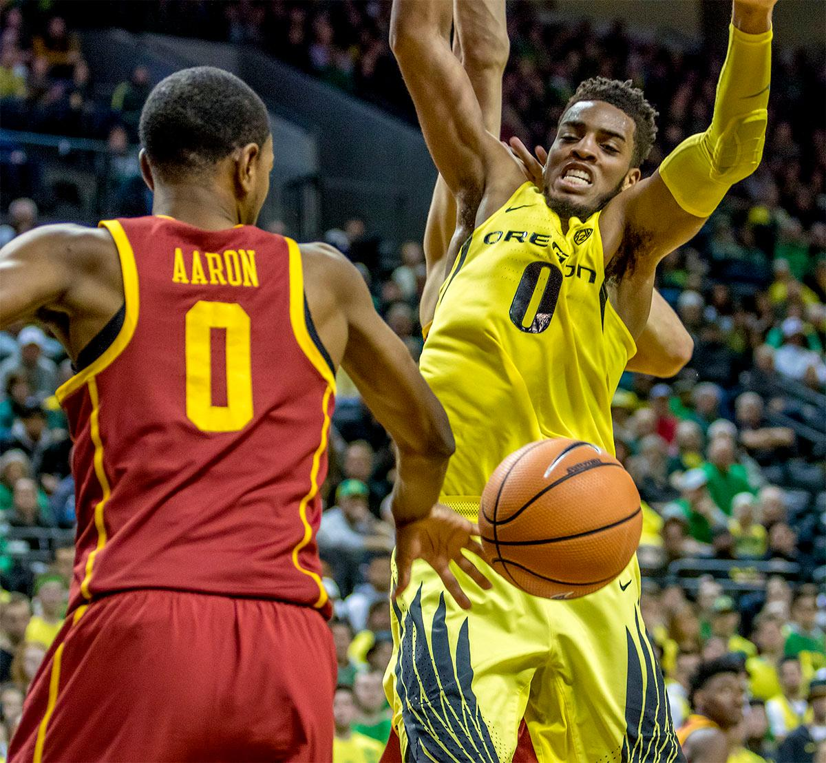 The Duck's Troy Brown Jr. (#0) attempts to make the rebound. The UO Ducks basketball team suffered a loss to the USC Trojans, 75-70, at Matthew Knight Arena on Thursday. Payton Pritchard lead the scoring with 18 points. The Ducks are now 2-4 in conference play and 12-7 overall. The Ducks will next play the UCLA at Matthew Knight Arena at 7:15 p.m. on Saturday, Jan. 20. Photo by August Frank, Oregon News Lab