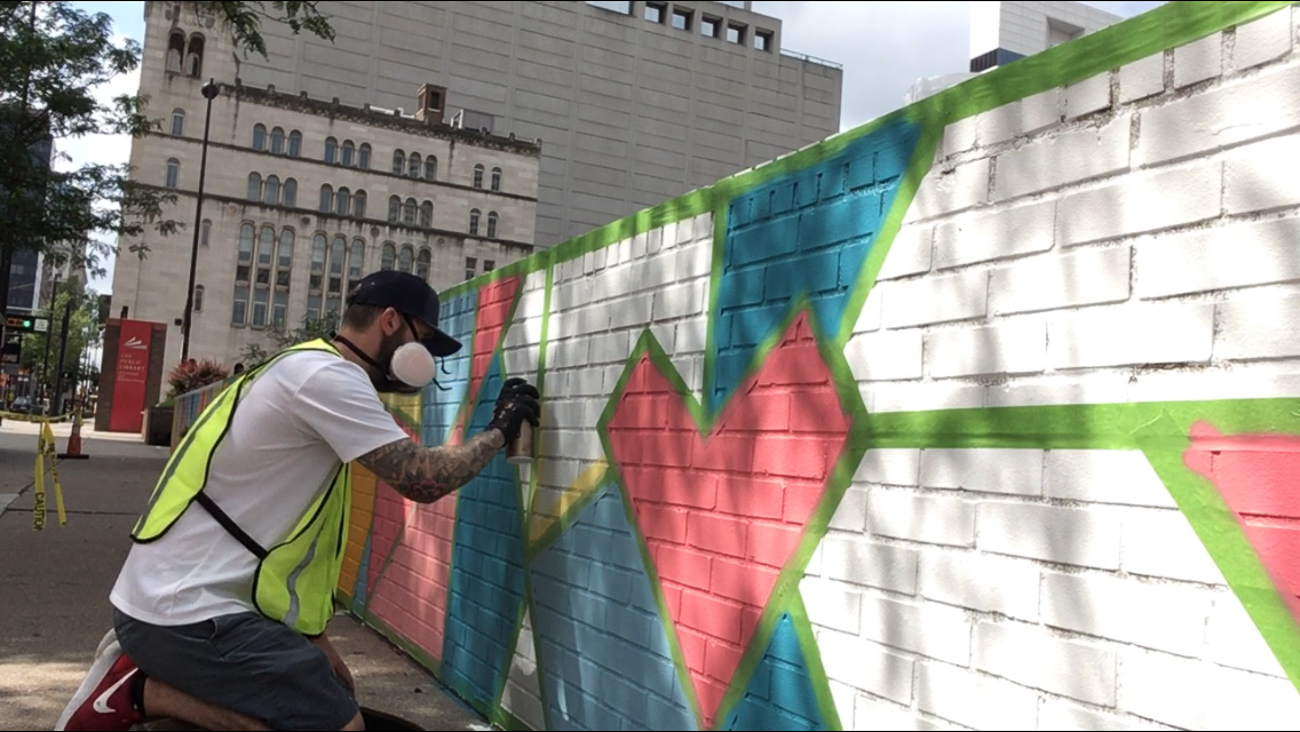 Josh uses spray paint to create his murals. The process, he says, usually takes around 2 days to complete. So long as the sponsor covers the cost of his paints and they give him permission, he'll design an original piece for their wall. / Image courtesy of Josh Stout // Published: 8.10.19