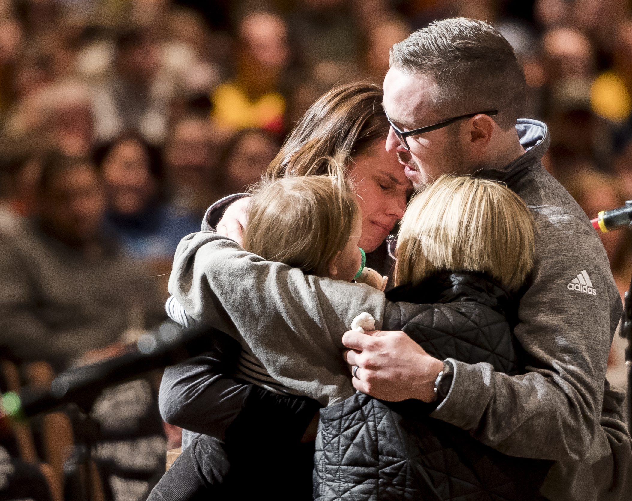 Gracie Zacakri, left, is embraced by her small group as family, friends, and community attended a remembrance and candlelight vigil for Deputy Zackari Parrish at Mission Hills Church in Littleton, Colo., Monday, Jan. 1, 2018.{&amp;nbsp;} (Dougal Brownlie/The Gazette via AP)<p></p>