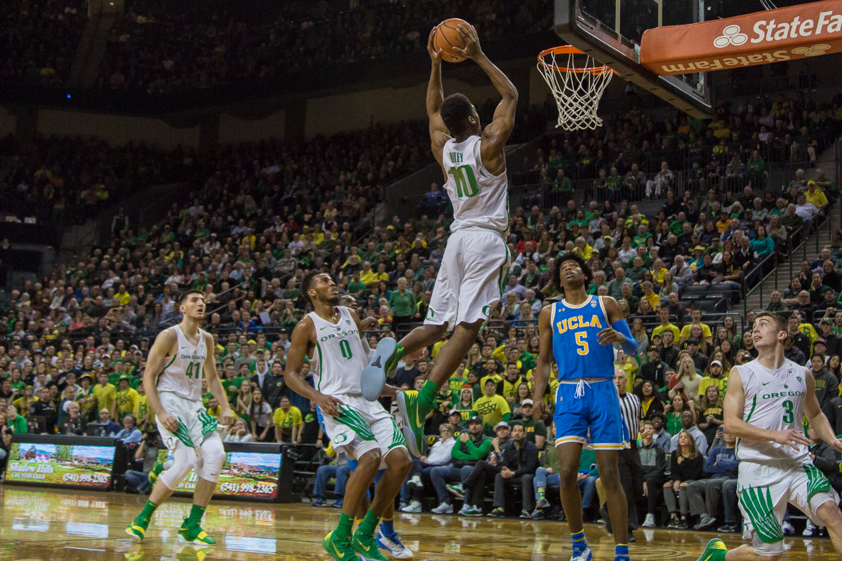 Oregon guard Victor Bailey (#10) dunks the ball. The Oregon Ducks men's basketball team defeated the UCLA Bruins 94-91 Saturday night in front of a home crowd at Matthew Knight Arena. The win brings the Ducks 13-7 overall for the season and 3-4 in Pac-12 play. Photo by Dillon Vibes