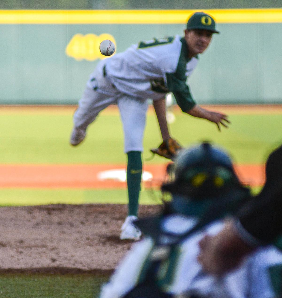 Ducks pitcher James Acuna (#28) fires the ball in an attempt to strikeout the Lion batter. On Wednesday night the Ducks fell to the Loyola Marymount Lions 4-0 at PK Park. Photo by Jacob Smith, Oregon News Lab