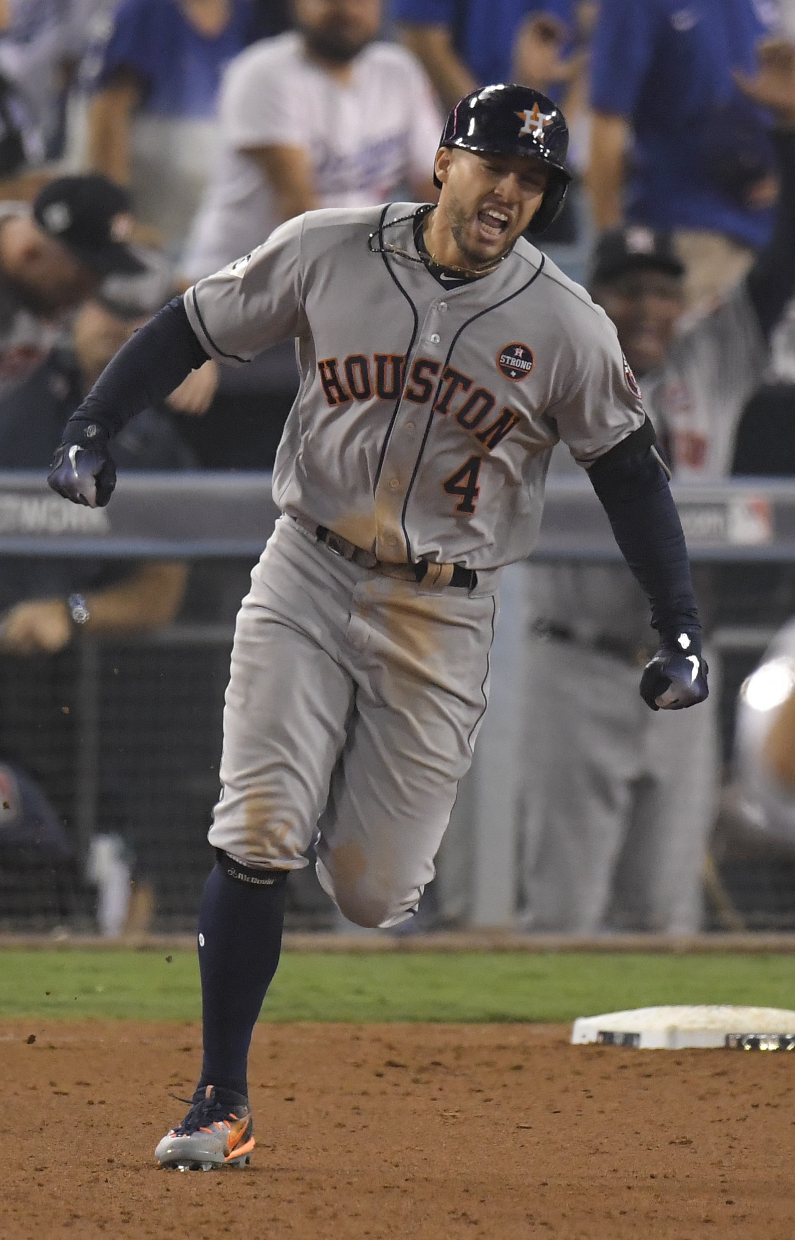 Houston Astros' George Springer celebrates after a home run against the Los Angeles Dodgers during the 11th inning of Game 2 of baseball's World Series Wednesday, Oct. 25, 2017, in Los Angeles. (AP Photo/Mark J. Terrill)