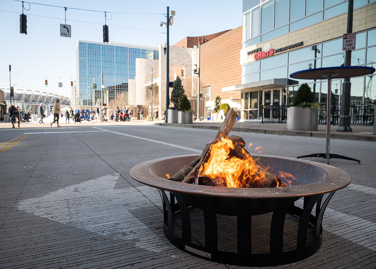 Fire pits give the street a pleasant bonfire smell. Frontgate's lounge area is a comfortable spot to post up and wait for the half-hourly blizzard the large fans along the sides of the street produce. / Image: Phil Armstrong, Cincinnati Refined // Published: 1.6.20