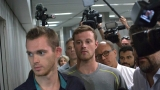 American swimmers released, will talk to police Thursday