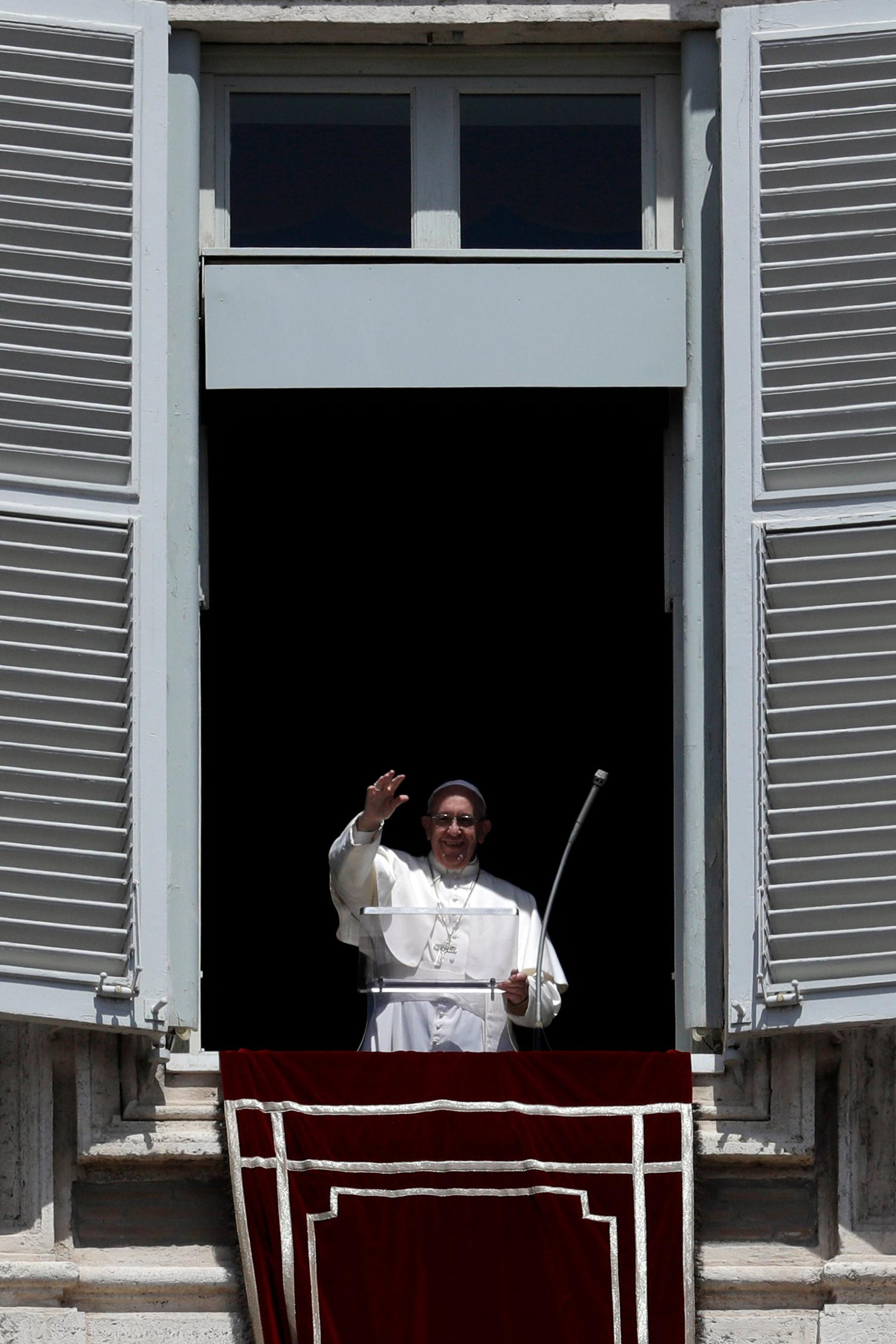 Pope Francis waves to faithful from his studio's window overlooking St. Peter's Square on the occasion of the Regina Coeli noon prayer at the Vatican, Sunday, May 14, 2017. (AP Photo/Gregorio Borgia)
