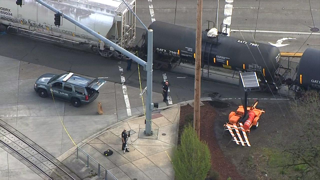 Police conduct an investigation after a train struck a pedestrian in Beaverton at Southwest Lombard and Beaverton Hillsdale Highway on Thursday. (Photo: Chopper 2/KATU News)