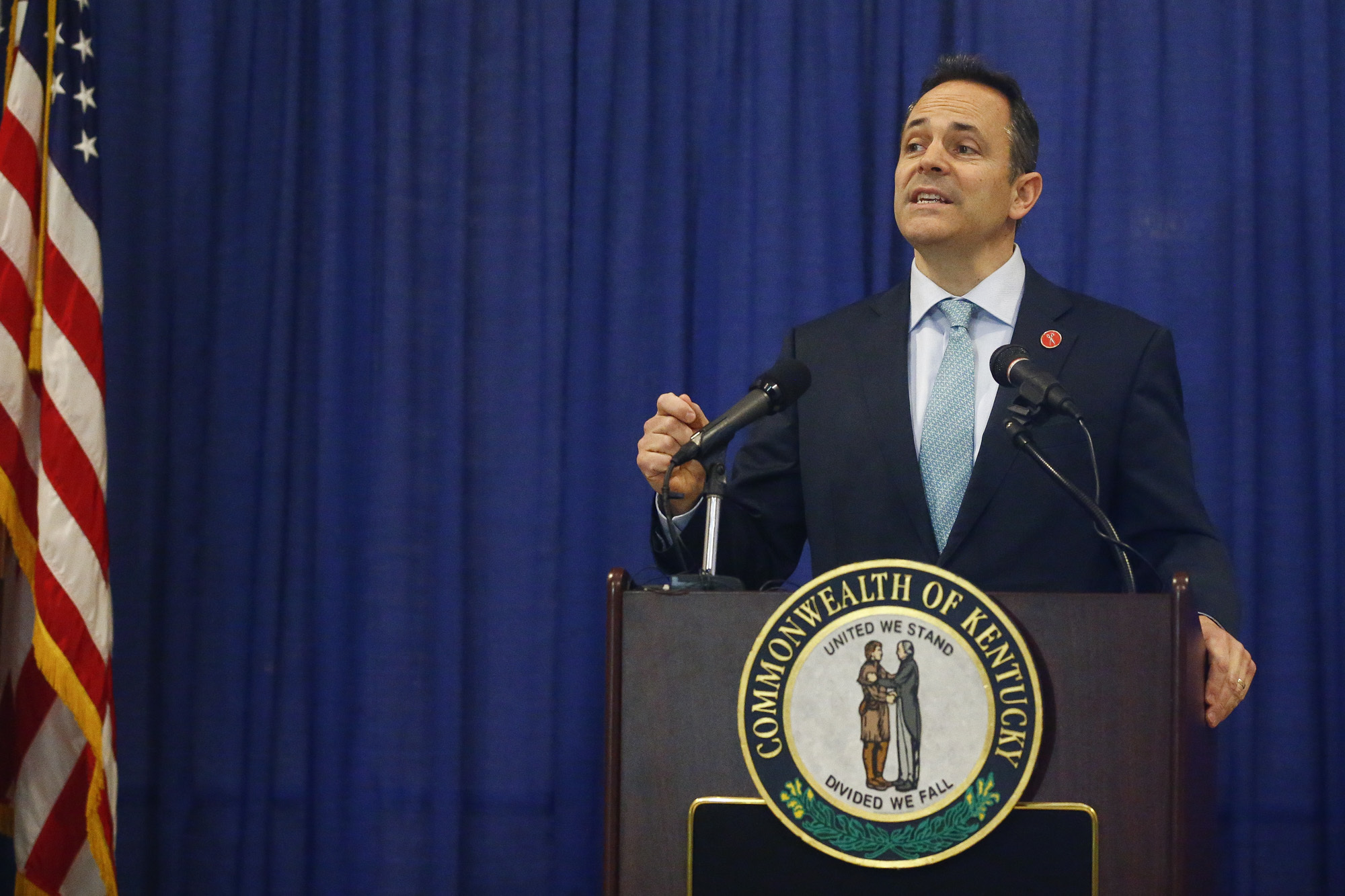 Kentucky Gov. Matt Bevin announces federal approval of Kentucky's Medicaid waiver in the Capitol Rotunda in Frankfort, Ky., Friday, Jan. 12, 2018.  Kentucky became the first state to require many of its Medicaid recipients to work to receive coverage, part of an unprecedented change to the nation's largest health insurance program under the Trump administration. (Alex Slitz/Lexington Herald-Leader via AP)