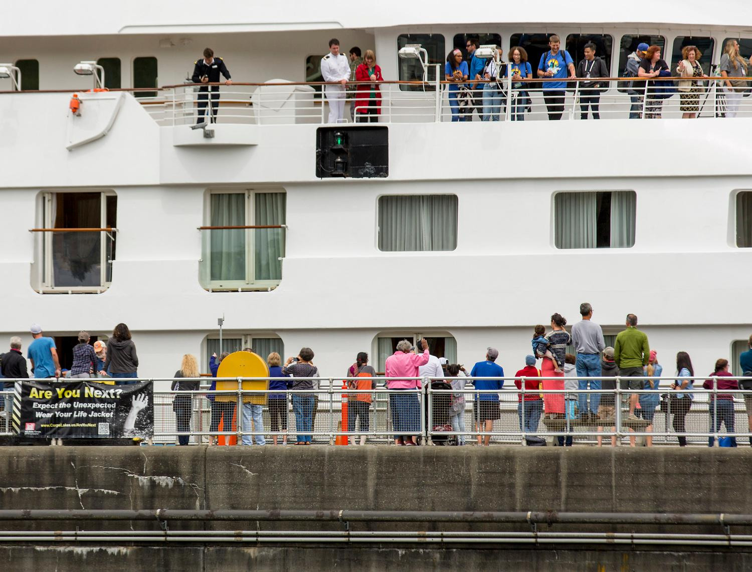 Star Legend became the largest cruise ship ever to transit Chittenden Locks in Ballard and the century-old Lake Washington Ship Canal through Ballard and Fremont, to sail on to Lake Union as part a celebration of Pacific Northwest cruising. Star Legend is owned by Seattle-based Windstar Cruises, a small ship cruise line with a fleet of six ships, and is sailing her inaugural season in Alaska from May to Sept., offering boutique, expedition cruising in luxurious, all-suite accommodations. (Sy Bean / Seattle Refined)
