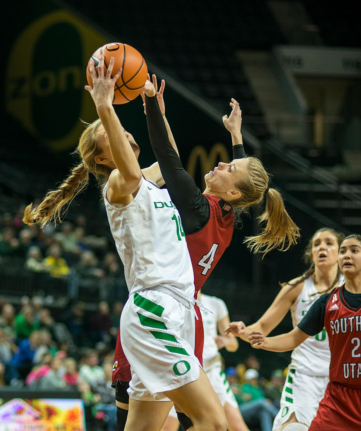 Oregon Ducks Lydia Giomi (#14) attempts to keep control of the ball. The University of Oregon Ducks women basketball team defeated the Southern Utah Thunderbirds 98-38 in Matthew Knight Arena Saturday afternoon. The Ducks had four players in double-digits: Ruthy Hebard with 13; Mallory McGwire with 10; Lexi Bando with 17 which included four three-pointers; and Sabrina Ionescu with 16 points. The Ducks overwhelmed the Thunderbirds, shooting 50% in field goals to South Utah's 26.8%, 53.8% in three-pointers to 12.5%, and 85.7% in free throws to 50%. The Ducks, with an overall record of 8-1, and coming into this game ranked 9th, will play their next home game against Ole Miss on December 17. Photo by Rhianna Gelhart, Oregon News Lab