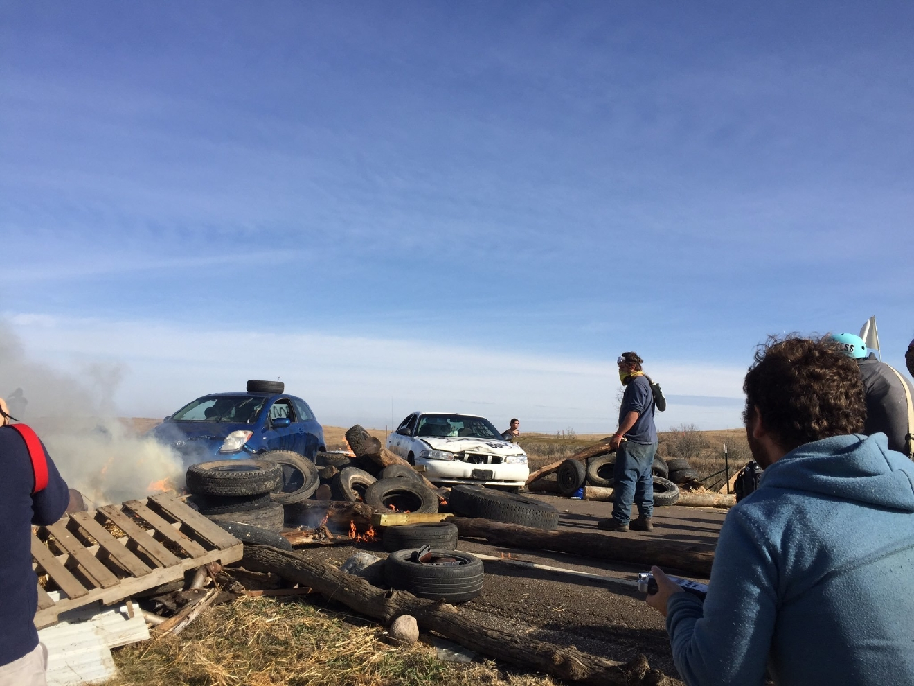 Dakota Access pipeline protesters confront law enforcement on Thursday, Oct. 27, 2016, near Cannon Ball, N.D. The months-long dispute over the four-state, $3.8 billion pipeline reached a crisis point when the protesters set up camp on land owned by pipeline developer Energy Transfer Partners. The disputed area is just to the north of a more permanent and larger encampment on federally-owned land where hundreds of protesters have camped for months.   (Caroline Grueskin/The Bismarck Tribune via AP)