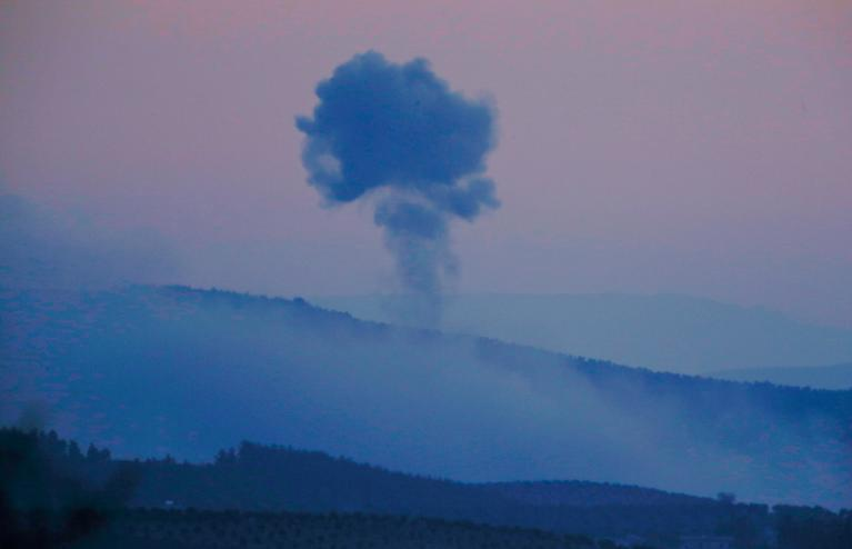 "Plumes of smoke rise on the air from inside Syria, as seen from the outskirts of the border town of Kilis, Turkey, Saturday, Jan. 20, 2018. Turkish jets have begun an aerial offensive, codenamed operation ""Olive Branch"", against the Syrian Kurdish-held enclave of Afrin, in northwest Syria . A military statement says the operation launched Saturday aims to protect Turkey's borders, ""neutralize"" Syrian Kurdish fighters in the enclave and to save the local population from their ""pressure and oppression."" (AP Photo/Lefteris Pitarakis)"