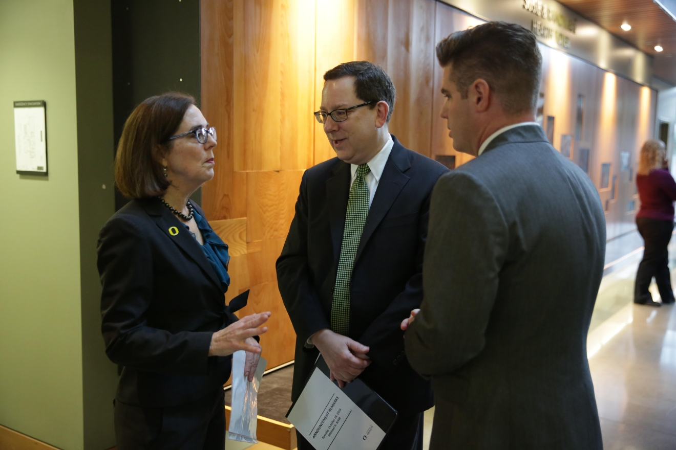 University of Oregon president Michael H. Schill speaks with Oregon governor Kate Brown during the announcement of the new Phil and Penny Knight Campus for Accelerating Scientific Impact on Tuesday, Oct. 18, 2016, at the Ford Alumni Center on the campus of the University of Oregon in Eugene, Oregon. (Courtesy University of Oregon)