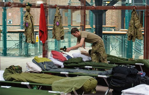 A soldier organizes his sleeping quarters at a temporary Army barracks at Tobacco Dock, a former shopping center in east London.