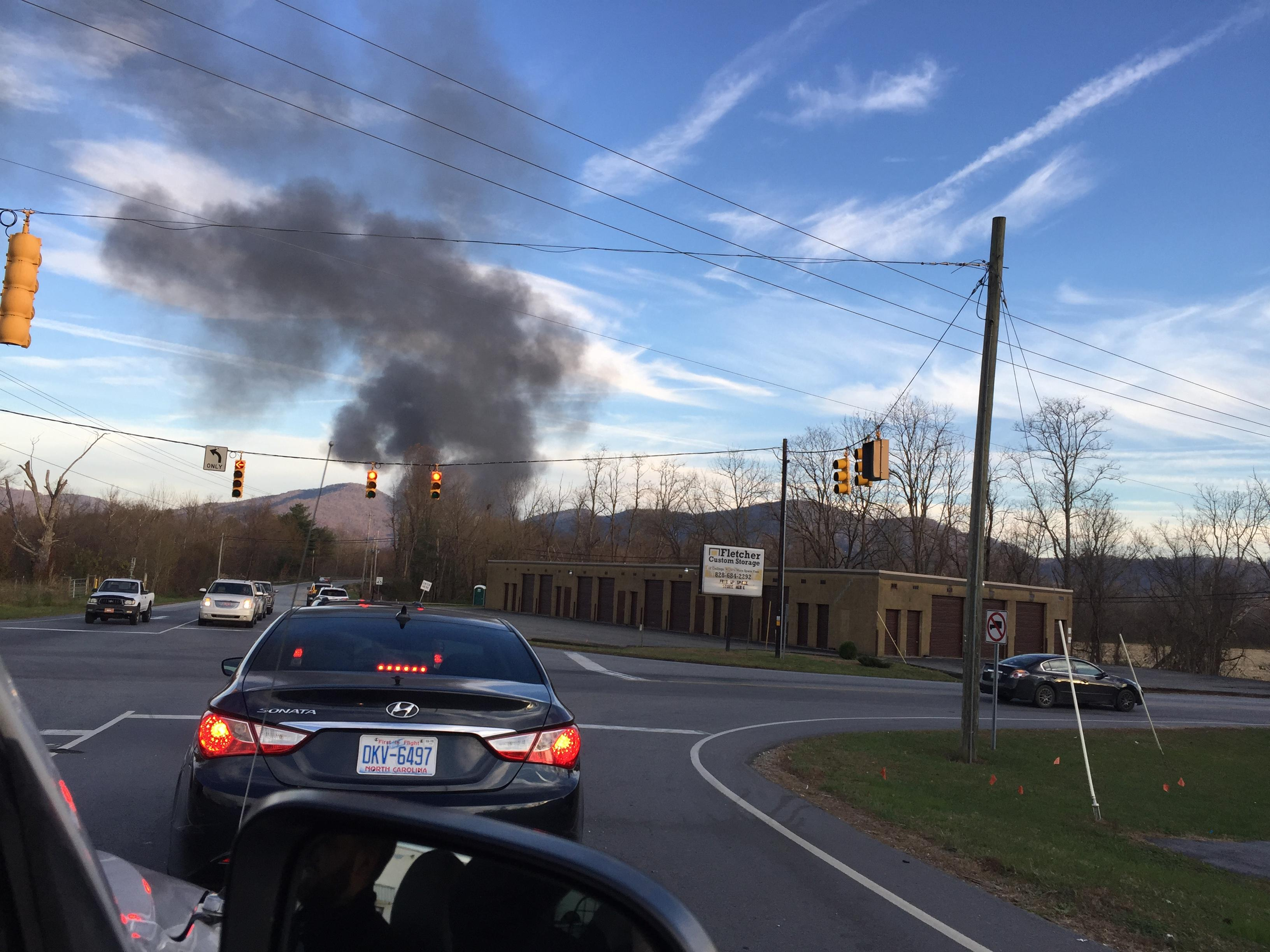 Henderson County emergency officials said the structure fire, reported a little after 4 p.m., was on the 200 block of Mills Gap Road. (Photo credit: WLOS Staff)