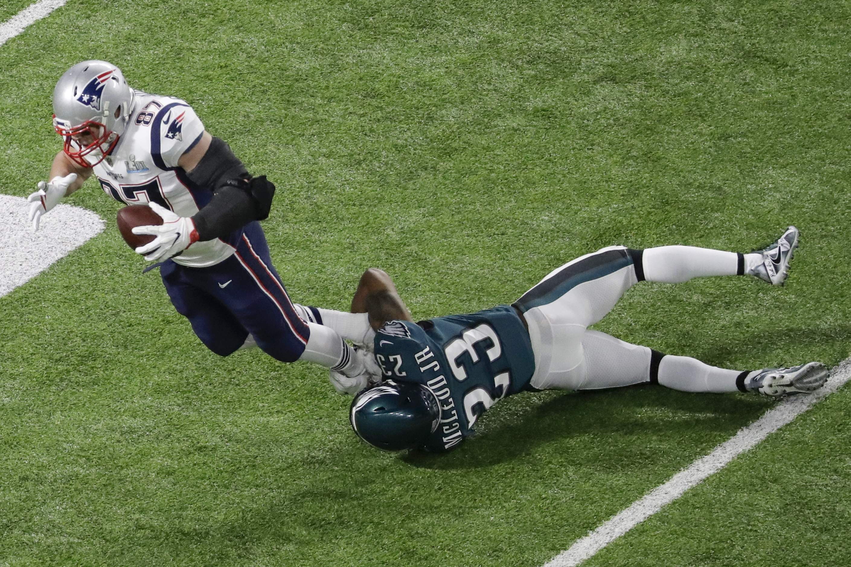 New England Patriots tight end Rob Gronkowski (87) is tackled by Philadelphia Eagles free safety Rodney McLeod Jr. during the first half of the NFL Super Bowl 52 football game Sunday, Feb. 4, 2018, in Minneapolis. (AP Photo/Eric Gay)