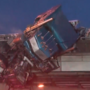 Driver dies after wreck, truck hangs from Dallas overpass