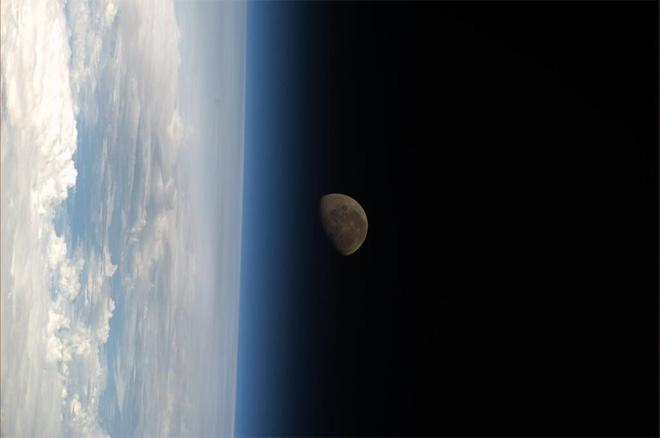 The moon setting on the blue earth atmosphere (Photo & Caption courtesy Koichi Wakata (@Astro_Wakata) and NASA)