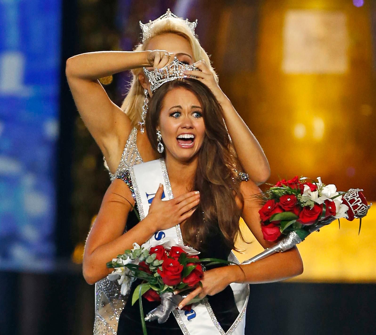 FILE – In this Sept. 10, 2017, file photo, Miss North Dakota Cara Mund reacts after being named Miss America. (AP Photo/Noah K. Murray, File)