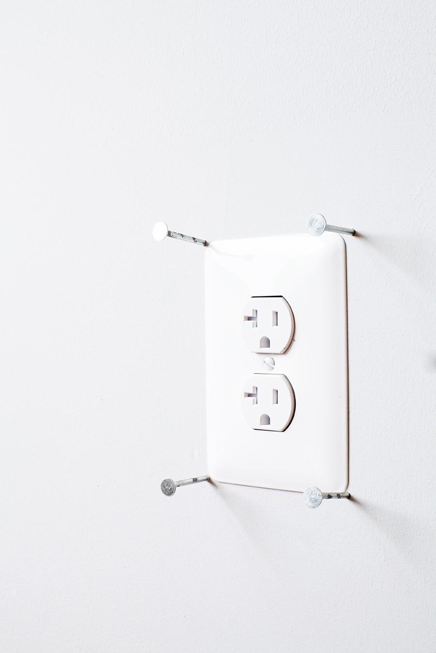 Pro Tip: Make sure to put four nails around any outlets like this. (Image: Ashley Hafstead)