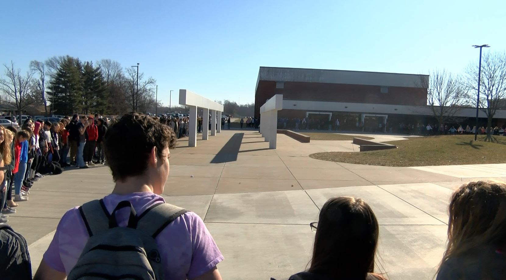 QHS students form a circle for 17 minutes of silence to remember Parkland victims (KHQA/Marcus Espinoza).{&amp;nbsp;}<p></p>