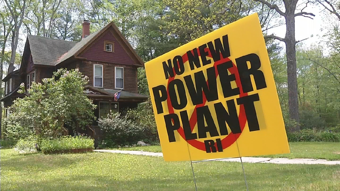 A sign opposing the proposed Invenergy power plant in Burrillville. (WJAR)
