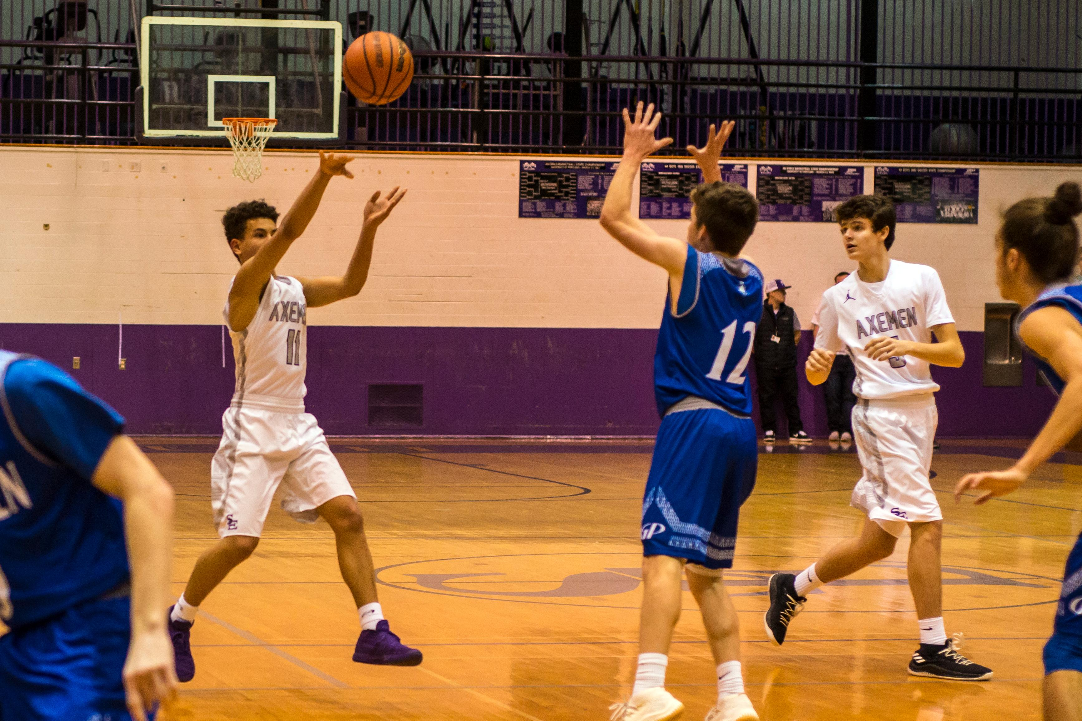 Grants Pass picks up a big SWC win over South Eugene with a 69-63 OT win. Jay Elmore (2) led all scorers with 31 points for the Axemen, while Taylor Anderson had 16 for the Cavemen (Photo by Colin Houck / For KMTR)<p></p>