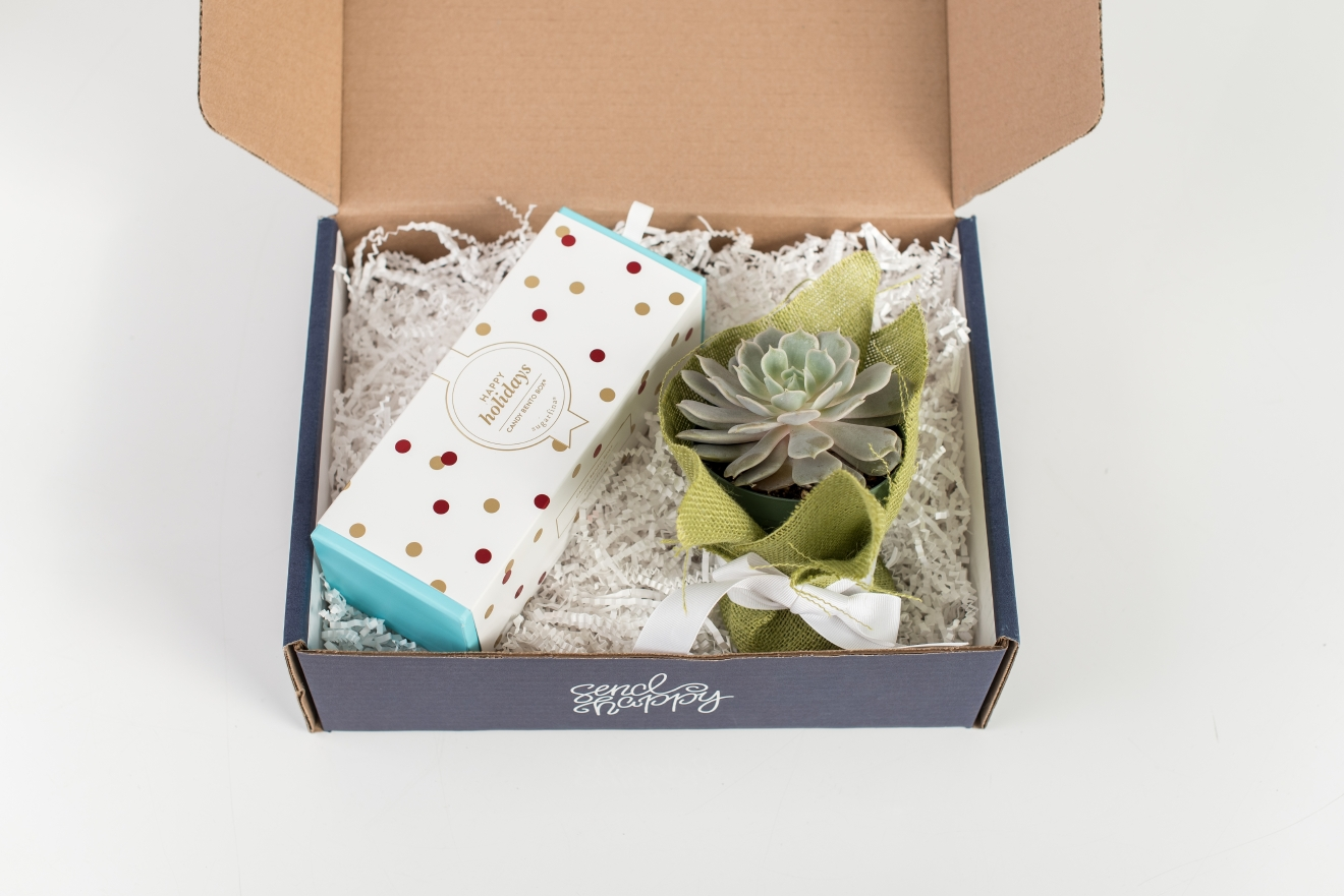 UrbanStems, Blitzen gift box ($45 with free-delivery) includes a burlap-wrapped succulent and a Sugarfina bento box filled with candy cane caramels, gingerbread cookie bites, and pumpkin pie caramels. (Photo: UrbanStems)