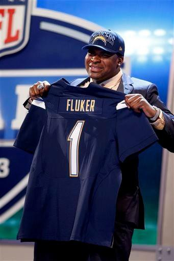 D.J. Fluker, from Alabama, holds up a team jersey after being selected 11th overall by the San Diego Chargers in the first round of the NFL football draft, Thursday night.