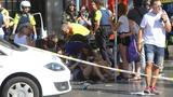 Police shoot suspects after van plows into Barcelona crowd, leaving 13 dead, 100 injured
