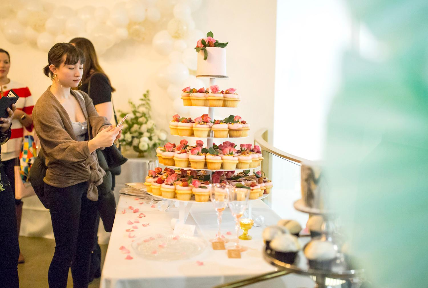 A tower of Raspberry Lemon Luxe cupcakes is on display for guests of the VIP Wedding Tasting at Trophy Cupcakes at the Bravern. Guests of the tasting were able to try the delectable cupcakes, 6-inch cakes, macarons, meringues, and other goodies on display while sipping champagne. (Sy Bean / Seattle Refined)<p></p>