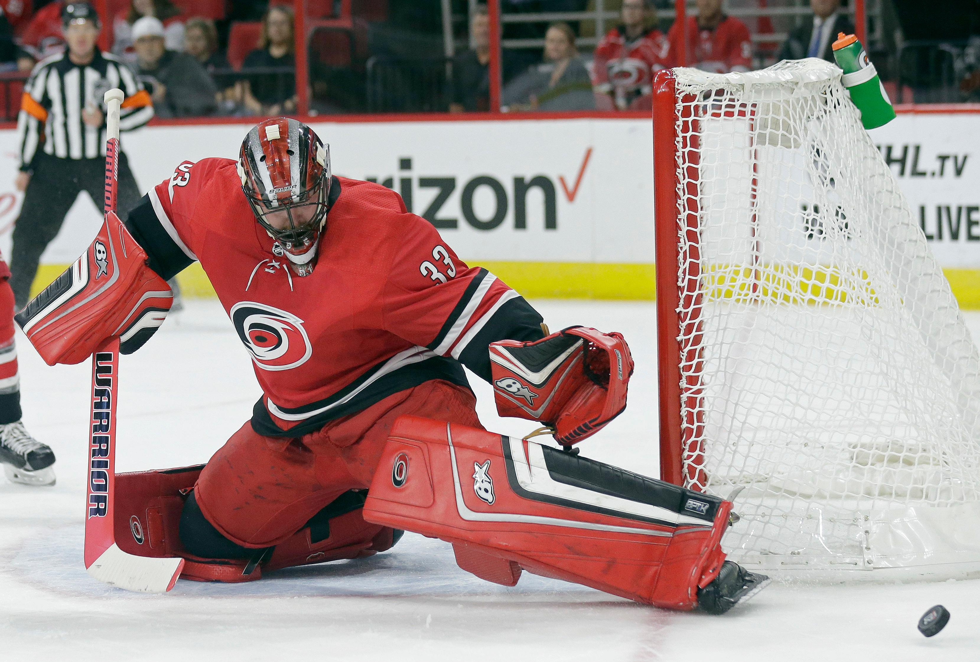 Carolina Hurricanes goalie Scott Darling (33) deflects the puck during the first period of an NHL hockey game against the Columbus Blue Jackets in Raleigh, N.C., Tuesday, Oct. 10, 2017. (AP Photo/Gerry Broome)