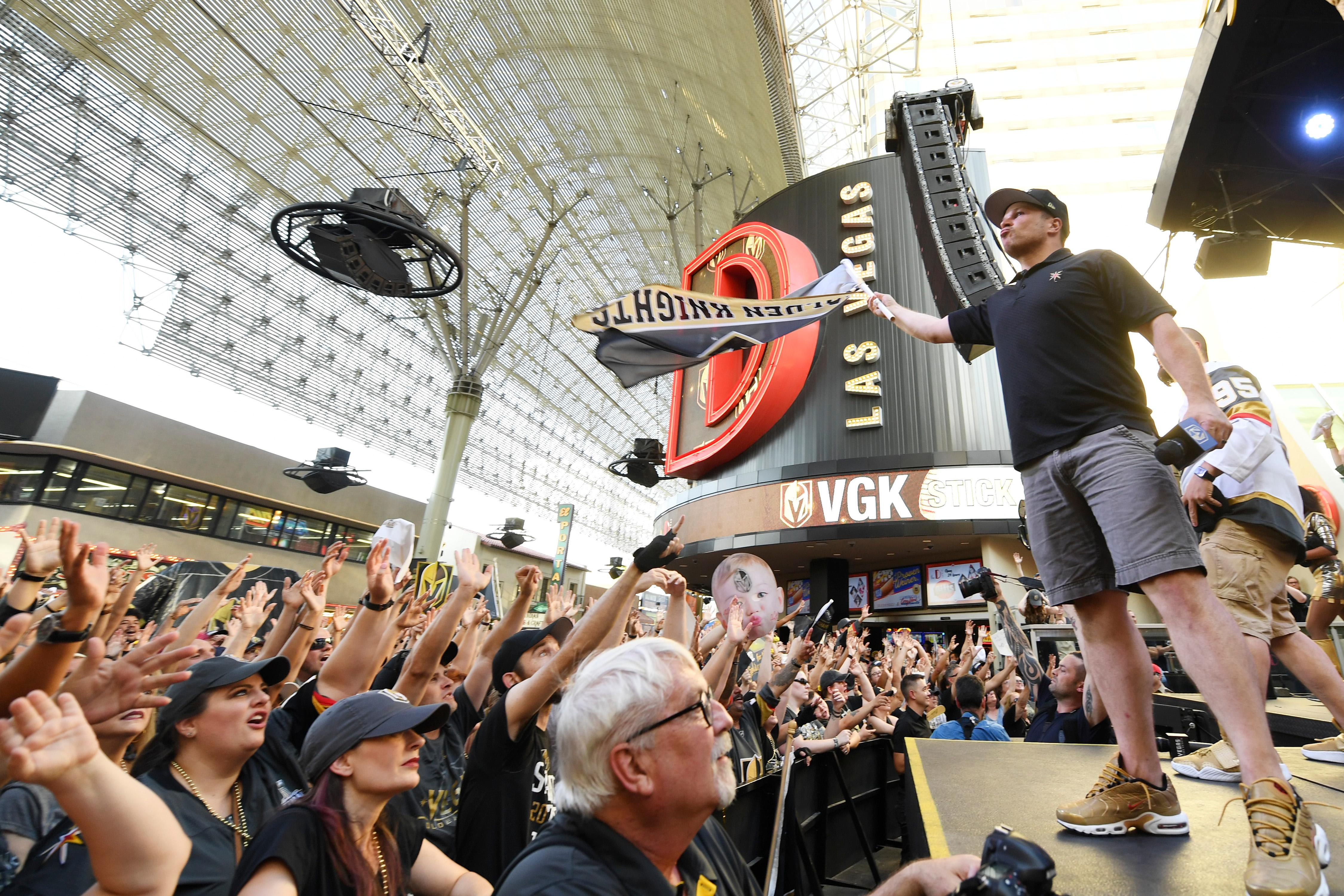 Arena announcer Mark Shunock waves a flag during a Vegas Golden Knights Stick Salute to Vegas fan appreciation rally at the Fremont Street Experience Wednesday, June 13, 2018. CREDIT: Sam Morris/Las Vegas News Bureau