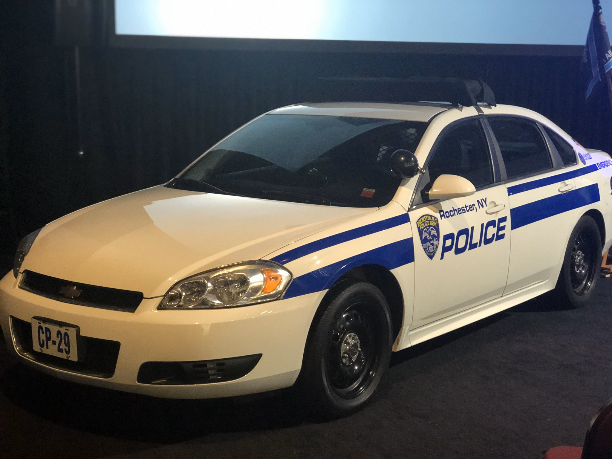 The patrol car used by Rochester Police Officer Manuel 'Manny' Ortiz sits at the front of the main room at the Joseph A. Floreano Rochester Riverside Convention Center on Friday, November 8, 2019 before the start of the memorial service. (WHAM photo)