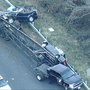 Officials: PG County crash flips over trailer bed carrying 2 cars causing 1 to catch fire