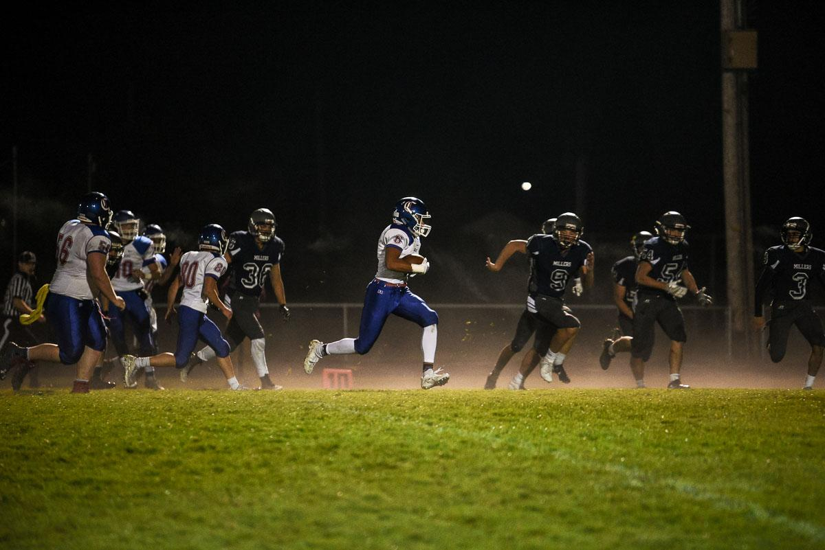 Churchill wide receiver Elijah Fields (#6) runs the ball into the end zone for a touchdown during the Lancer's 56-7 victory over Springfield remaining 7-0 on the season. Photo by Jeff Dean, Oregon News Lab