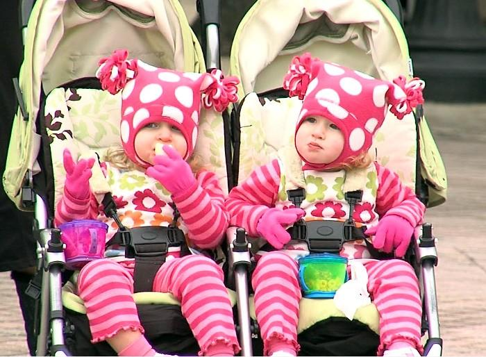 Kids watched along the street in downtown Birmingham as the circus rolled into town on Wednesday.