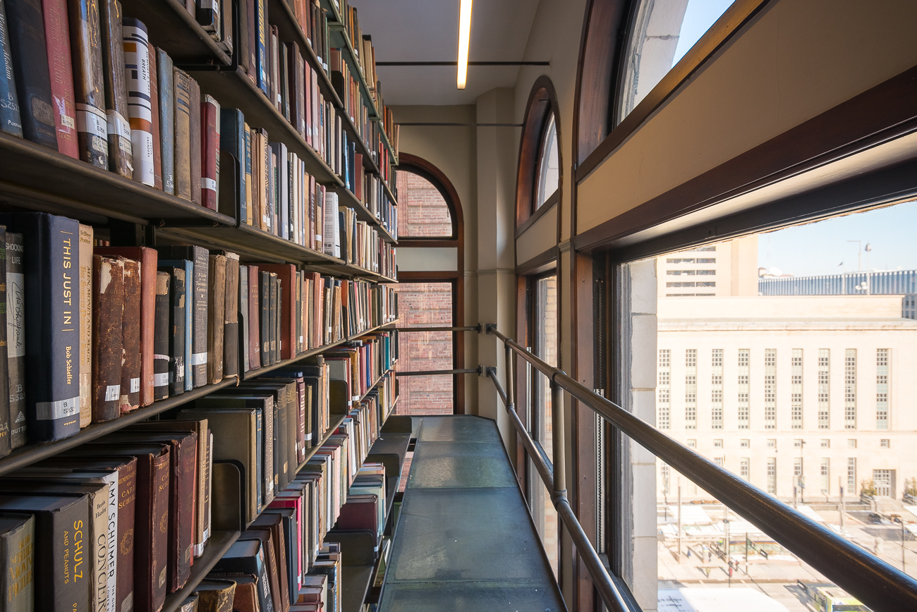 Two floors of stacks of books are kept at the north end of the library. Natural light and city views enhance the browsing experience. / Image: Phil Armstrong, Cincinnati Refined // Published: 2.7.18<p></p>