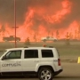 Residents begin returning to fire damaged Canadian oil city