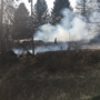 Brush fire spreads several acres, destroys 2 structures in Amsterdam