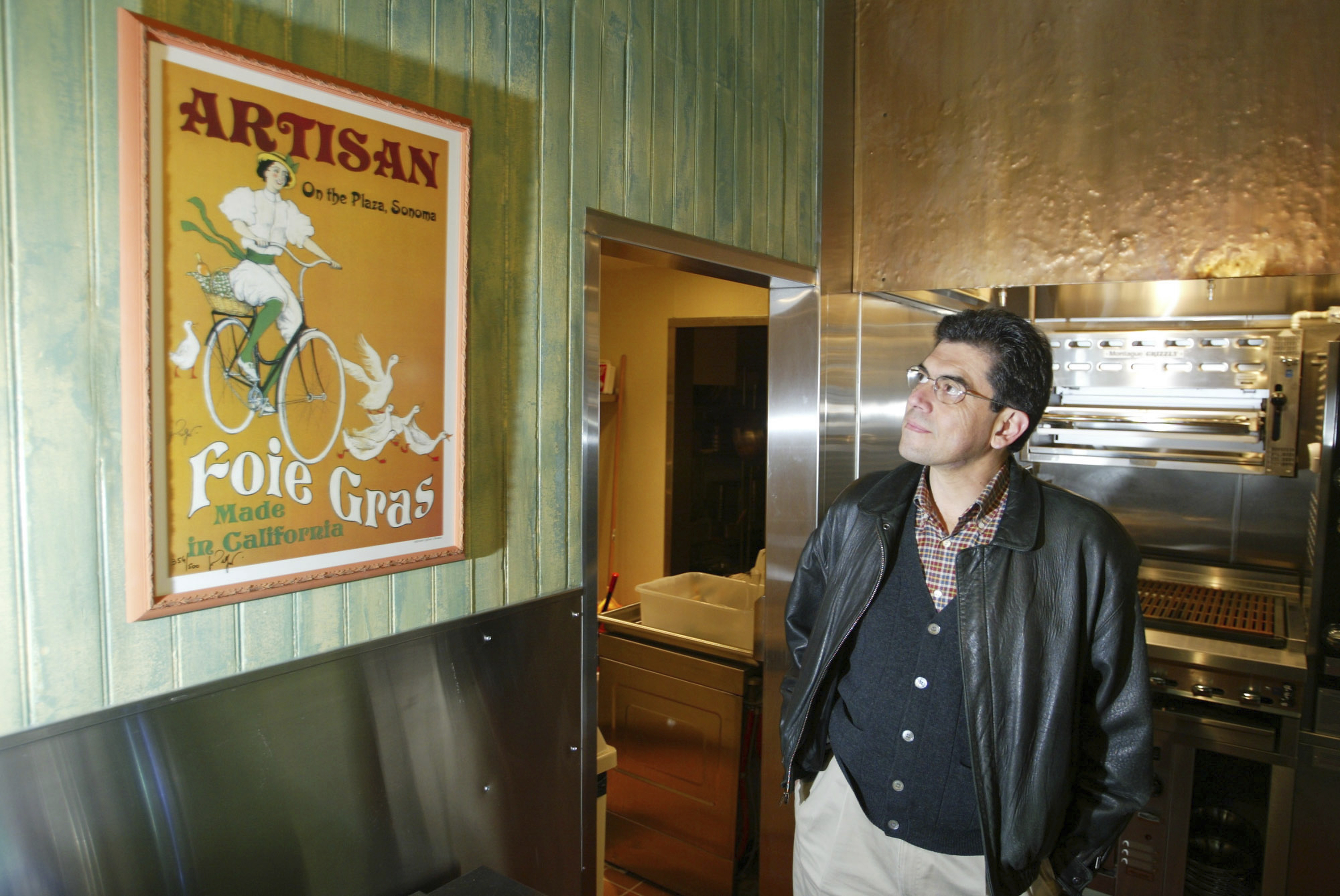 FILE - In this Dec. 9, 2003, file photo, Guillermo Gonzalez, owner of Sonoma Foie Gras, stands in the kitchen of his restaurant, Sonoma Saveurs in Sonoma, Calif. (AP Photo/Eric Risberg, File)