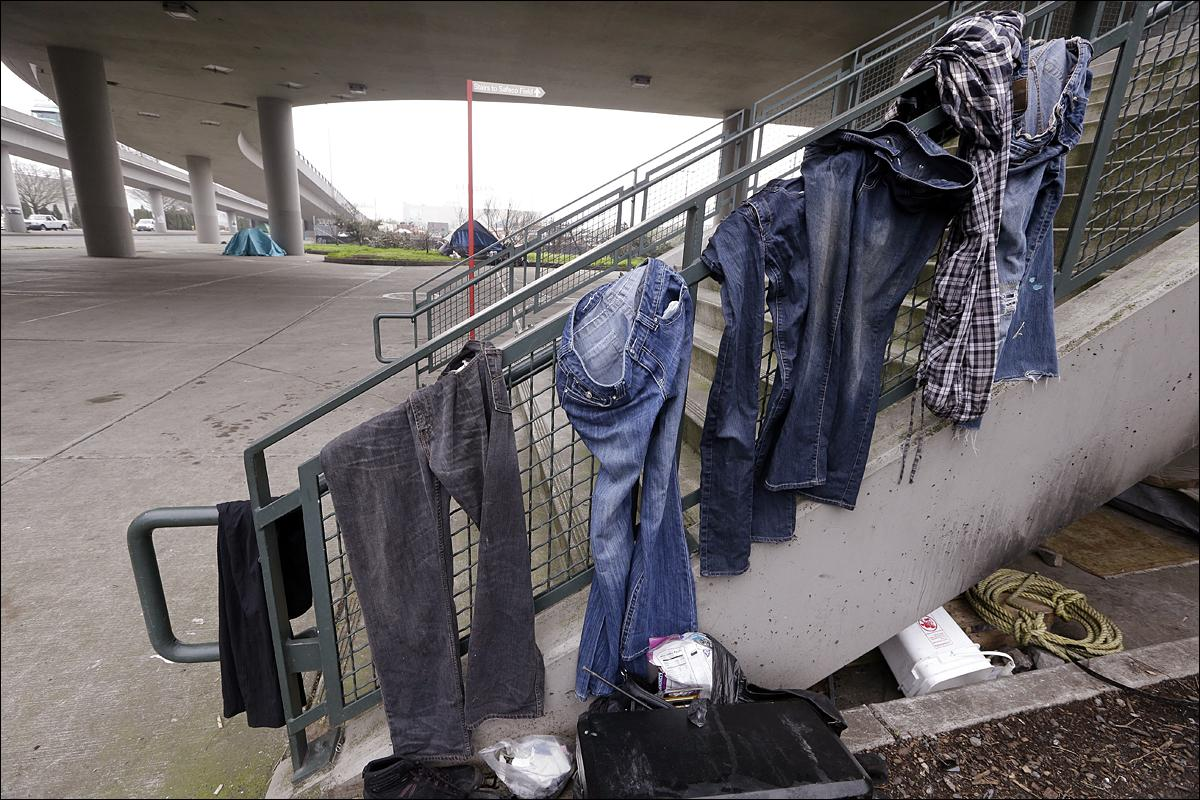 seattle in uncharted territory as homelessness spikes komo clothing hangs from the handrail of stairs near the baseball stadium at a small homeless encampment
