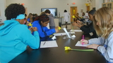 Asheville Middle School students dissect flowers, learn what makes them grow
