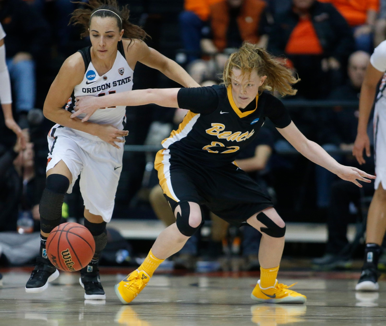 Oregon State's Gabriella Hanson, left, and Long Beach State's Madison Montgomery chase after a loose ball during the second half of a first-round game in the women's NCAA college basketball tournament Friday, March 17, 2017, in Corvallis, Ore. (AP Photo/ Timothy J. Gonzalez)