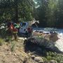 Postal truck crash sends boxes down creek near Leavenworth