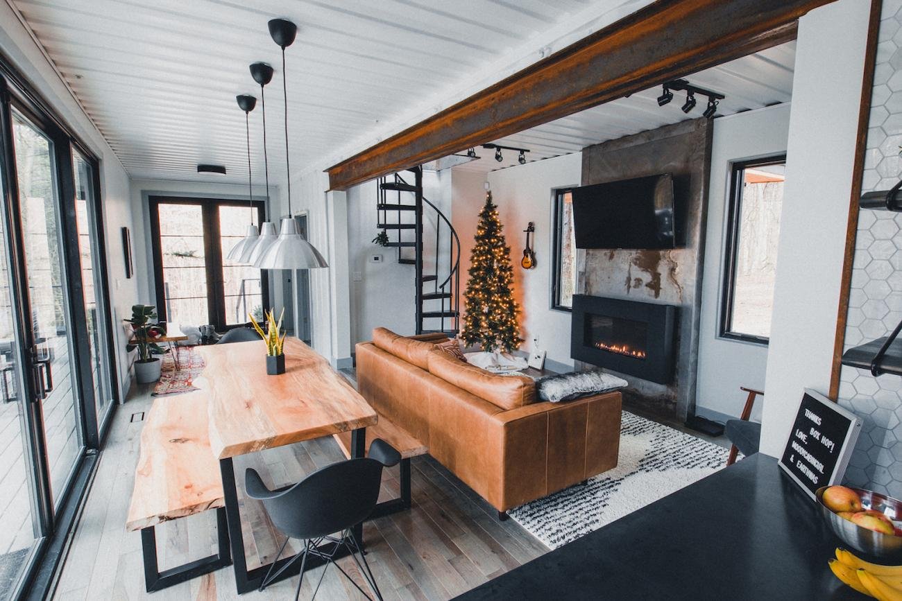 A steel and wood design covers the exterior while the interior is light, airy, and delightful with a Scandinavian aesthetic. An open floor plan, outdoor decks, and broad windows offer nature views. / Image courtesy of The Box Hop // Published: 5.5.19